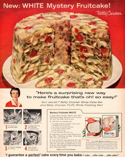 """Not merely a recipe for Fruitcake, or a Fruitcake,,, but leave it to Betty Crocker to engineer a recipe for a """"White Mystery Fruitcake"""". While everyone loves a good mystery novel or movie, fruitcake is already mysterious enough as it is. Regardless, this Betty Crocker ad, which was originally printed in Better Home & Gardens in 1958, touts a special recipe. The cake is prepared with white cake mix and white frosting, which does nothing to mask the already gross flavor of fruitcake."""